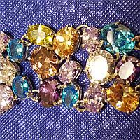 Браслет в серебре с цветными камнями ( желтый, сиреневый, фиолетовый, голубой и белый) вес 54.14 грамм
