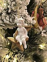 Елочная игрушка ангел сидящий на звезде Goodwill