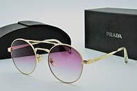 Круглые женские очки солнцезащитные Prada розовые