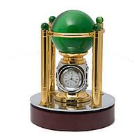 Шар из камня и измерительные приборы: часы, барометр, гигрометр