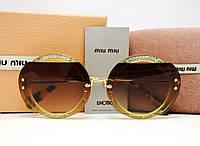 Солнцезащитные очки Miu Miu Reveal Evolution SMU 06S (Brown-leo)