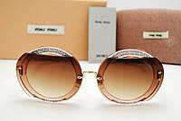 Солнцезащитные очки Miu Miu Reveal Evolution SMU 06S (Pink-shine)