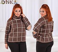 Женский свитер с разрезами на локтях