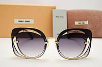 Солнцезащитные очки Miu Miu SMU 54S (серый градиент)
