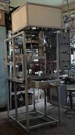 Автомат фасовочно-упаковочный с стаканчиковым дозатором для сыпучих продуктов.