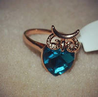 Кольцо сова с синим кристаллом.