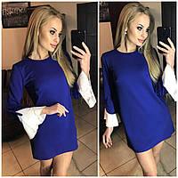 Женское платье синего цвета с манжетами