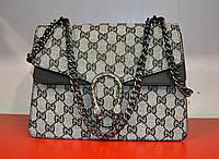 Стильная вечерняя женская сумочка на цепочке серого цвета