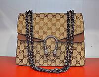 Модная женская сумочка на цепочке коричневого цвета