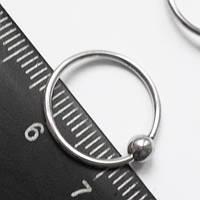 Кольцо сегментное для пирсинга: диаметр 14 мм,толщина 1.2 мм, шарик 4 мм. Сталь 316L.