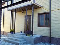 Утепление и облицовка фасада сайдингом каменным Донрок