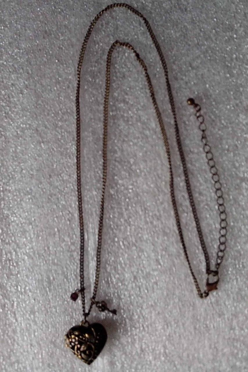 Талисманы на бронзовой цепочке антиквариат