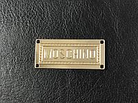 Пришивная металлическая эмблема Moschino 40х17мм