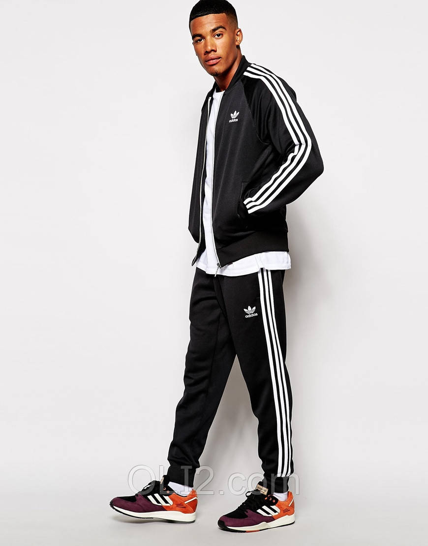 04fdbb17a00 Мужской трикотажный спортивный костюм Adidas адидас брюки манжет реплика