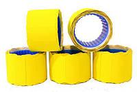Ценник фигурній, жёлтого цвета на ленте, размер 12*26, в рулоне 300 штук