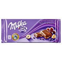 Шоколад MILKA Trauben-Nuss  100г С орехом и изюмом