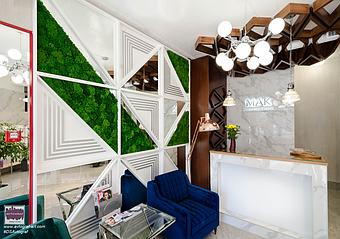 """""""Моя Академия Краси МАК""""   Структурований ісландський мох в перетинках і стіновому  панно додають природних  акцентів   в сучасний інтер'єр і є частиною природної кольорової гами разом з меблями, що виконані з натурального лакованого ясеня."""