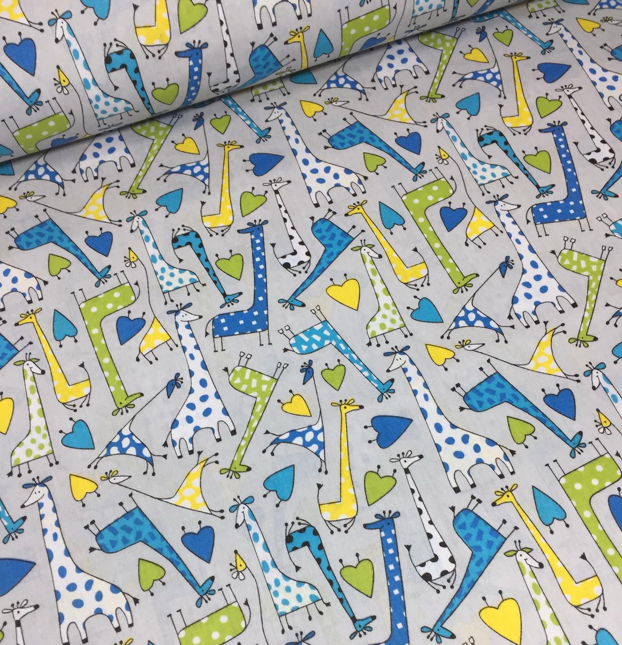 Хлопковая ткань польская жирафы желто-синие на сером №370