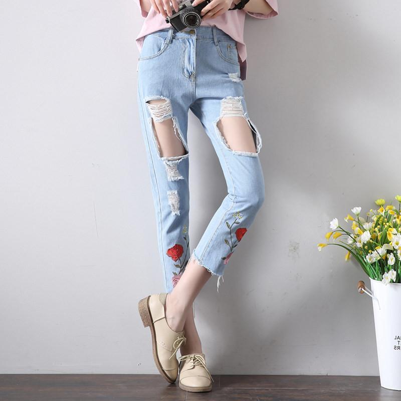 18549506774 Рваные джинсы женские с цветами DL7770 - Delirium