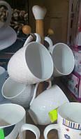 Набор чашек 4 шт. на деревянной подставке.