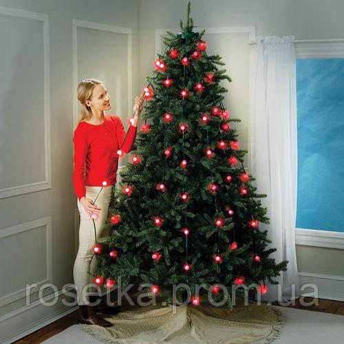 Новорічна конусна світлодіодна гірлянда Tree Dazzler на ялинку