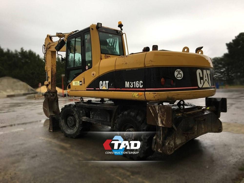 Колесный экскаватор Caterpillar M316C (2006 г)