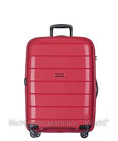 Дорожный чемодан из полипропилена на 4-х колесах (средний) Puccini Madagaskar красного цвета