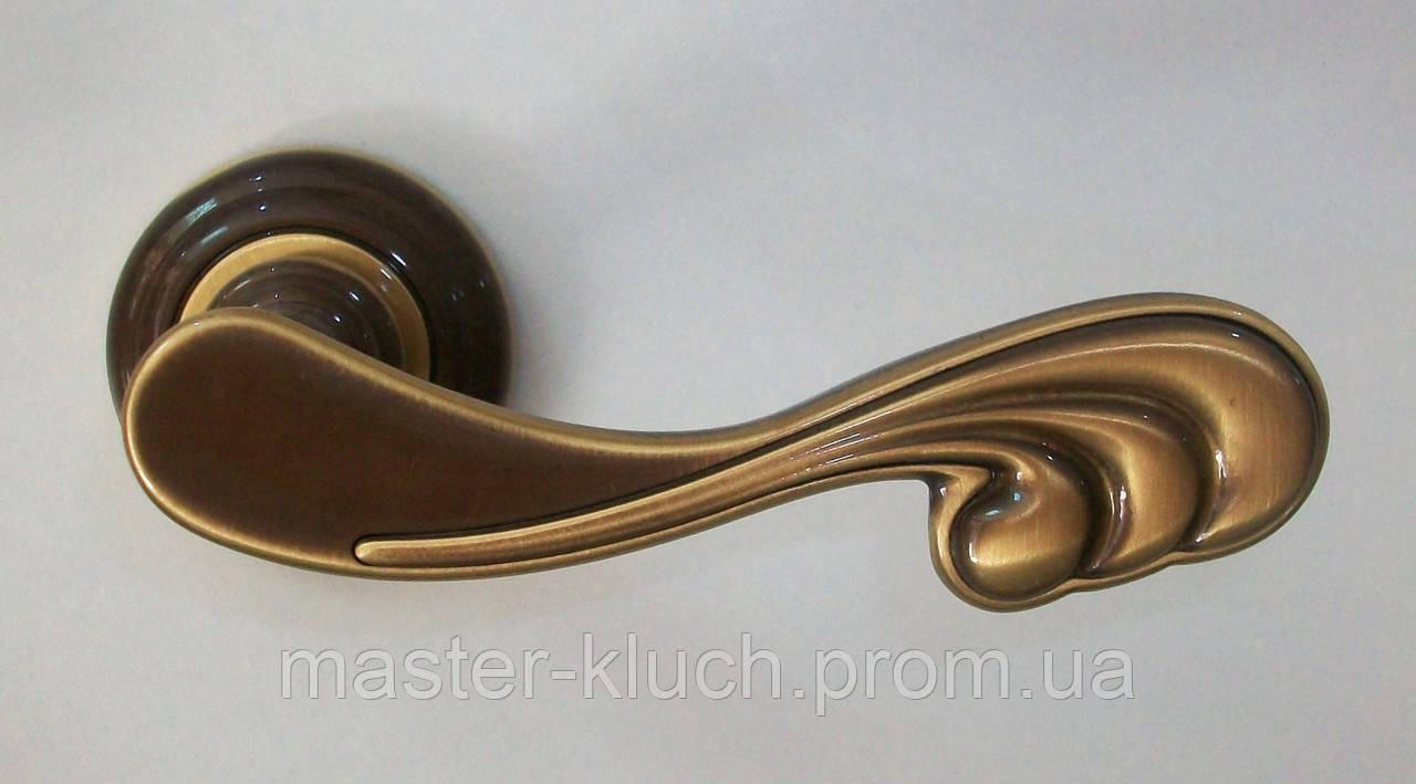 Дверная ручка Mandelli Soft PB/BR бронза