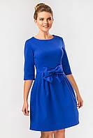 Нарядное женское вечернее синее платье с бантом спереди