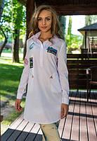 Біла подовжена жіноча сорочка з кольоровими нашивками Nika