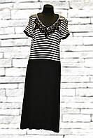 Чёрное приталенное платье до колен