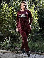 Модный женский костюм, штаны с карманами и кофта.