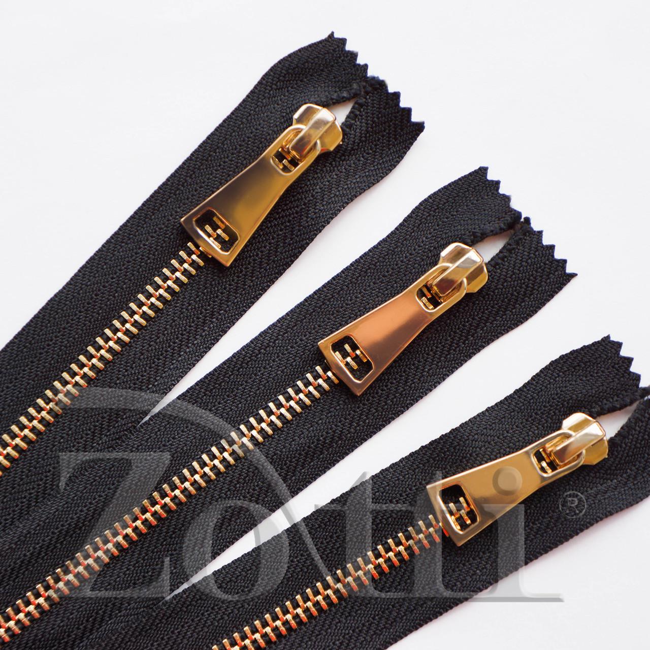Молния (змейка,застежка) металлическая №5, размерная, обувная, черная, с золотым бегунком № 115 - 20 см