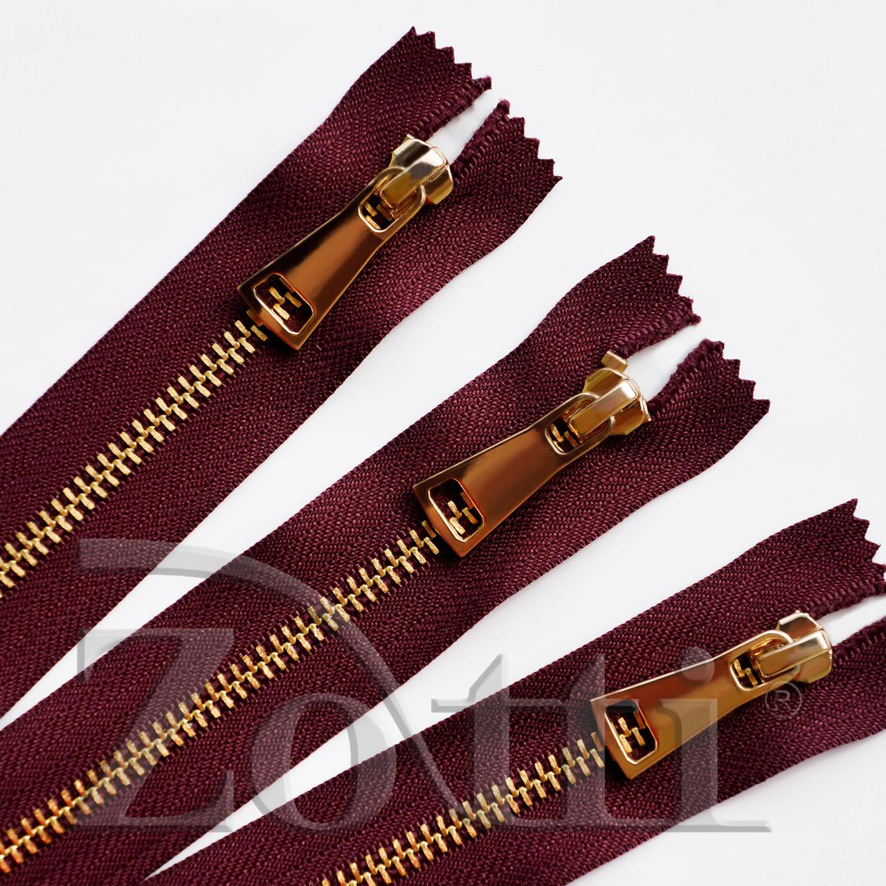 Молния (змейка,застежка) металлическая №5, размерная, обувная, бордовая, с золотым бегунком № 115 - 25 см