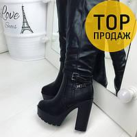 Женские зимние сапоги на каблуке 12 см, черного цвета / высокие сапоги женские кожаные, с ремешком, модные