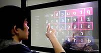 TransWall - прозрачный сенсорный дисплей, который можно использовать с обеих сторон