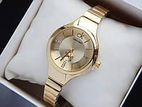 Женские кварцевые наручные часы Calvin Klein золотого цвета со стразами на циферблате, на тонком браслете