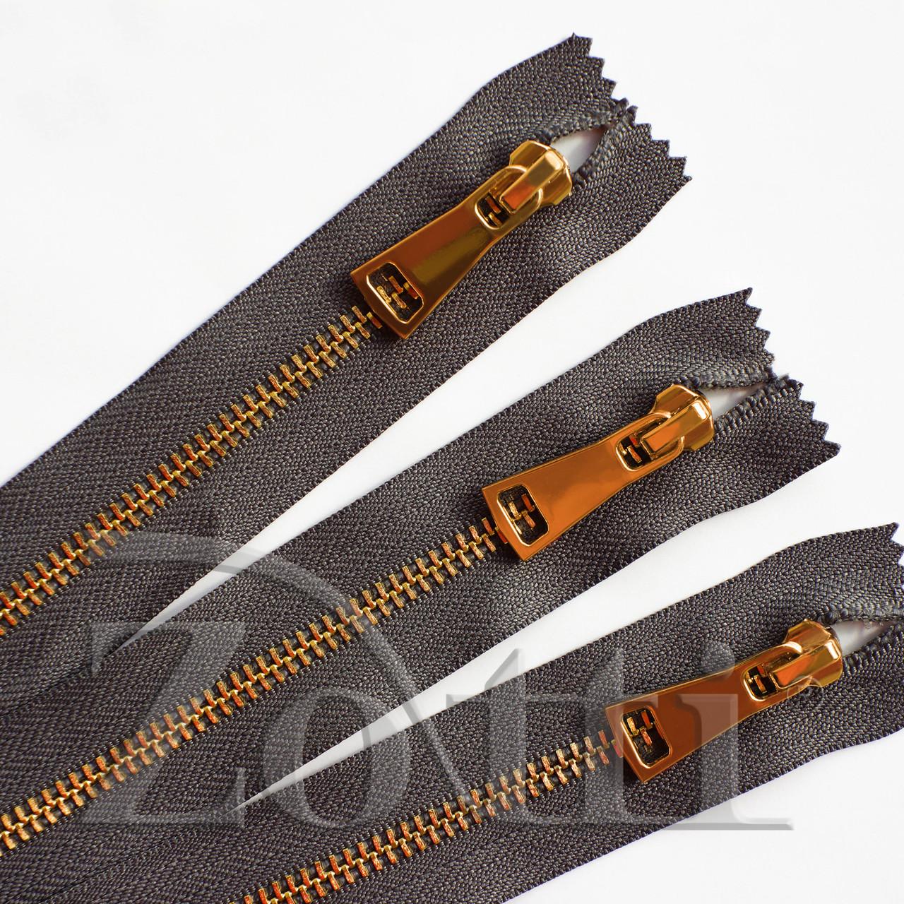 Молния (змейка,застежка) металлическая №5, размерная, обувная, серая, с золотым бегунком № 115 - 18 см