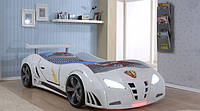 Кровать реально крутая и выглядит как настоящий автомобиль и полностью имитирует звуки. Блестящий глянцевый пластиковый корпус Снимающиеся колеса Прочные буковые ламели, не ДСП плита Кровать сигналит, светится. Сама бы играла ))