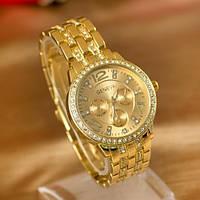 Женские кварцевые наручные часы Geneva золотые с металлическим ремешком и камушками