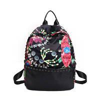 Женский рюкзак с ярким принтом