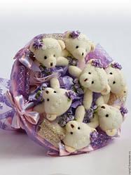 Букети з цукерок і плюшевих іграшок