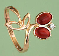 Золотий перстень з цирконом та поробними каменями