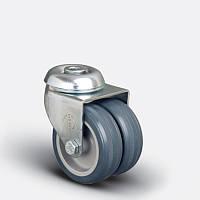 Сдвоенные аппаратные колеса поворотные с отверстием на серой резине диаметром 50 мм