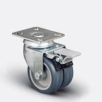 Сдвоенные аппаратные колеса поворотные с площадкой и тормозом на серой резине диаметром 50 мм