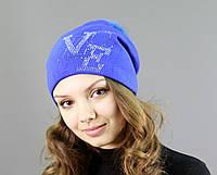 Яркая женская шапка с меховым бубоном