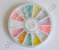 Разноцветные жемчужинки в карусельке разных размеров