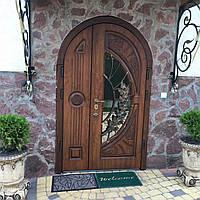 Двері вхідні металеві арочні з мдф накладками