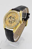Женские механические наручные часы Omega золотые с камнями с черным ремешком