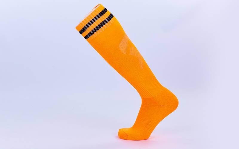 Гетры футбольные взрослые оранжевые с черной полосой CTM011-OR